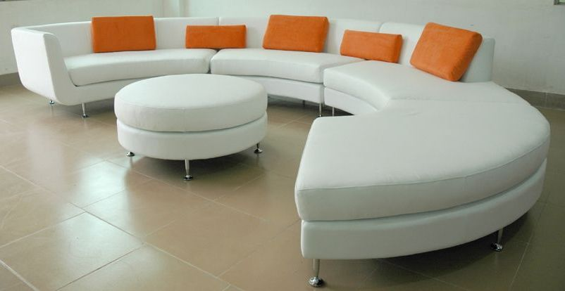 Contemporary White Sofa With Orange Pillows