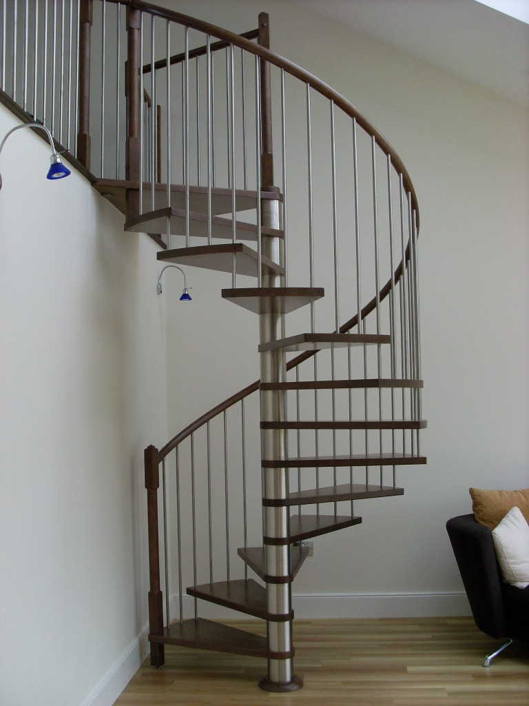 Spiral stairs design in minimalist house 4 home ideas for Spiral stair design