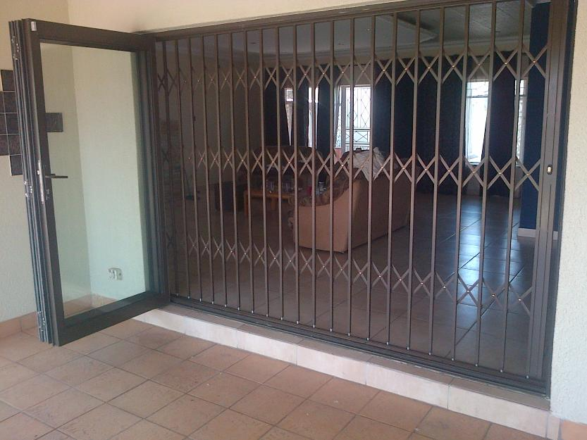 Wide Iron Trellis Door Inspiration Image