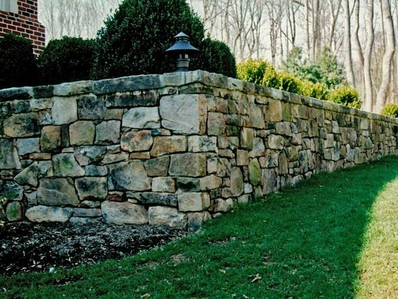 Minimalist Home Fence Made Of Natural Stone