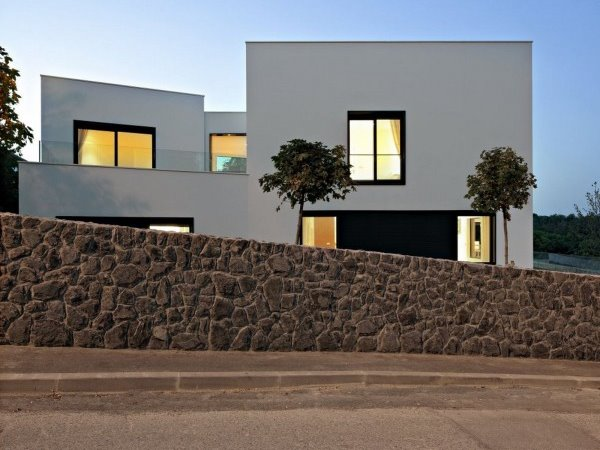 Minimalist Home With Natural Stone Fence