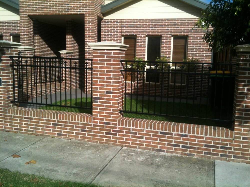 Minimalist fence design to create luxury home 4 home ideas for Brick and wrought iron fence designs